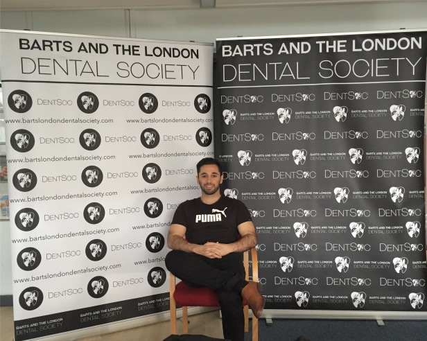 Ali with DentSoc banners